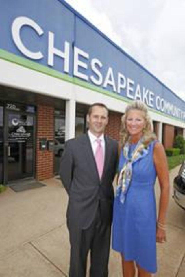Photo -  Jeffrey Moen, Oklahoma Center for Nonprofits board president,  and Marnie Taylor, Oklahoma Center for Nonprofits president and chief executive officer, pose Wednesday in front of the Chesapeake Community Plaza in Oklahoma City. [Photo By Steve Gooch, The Oklahoman]