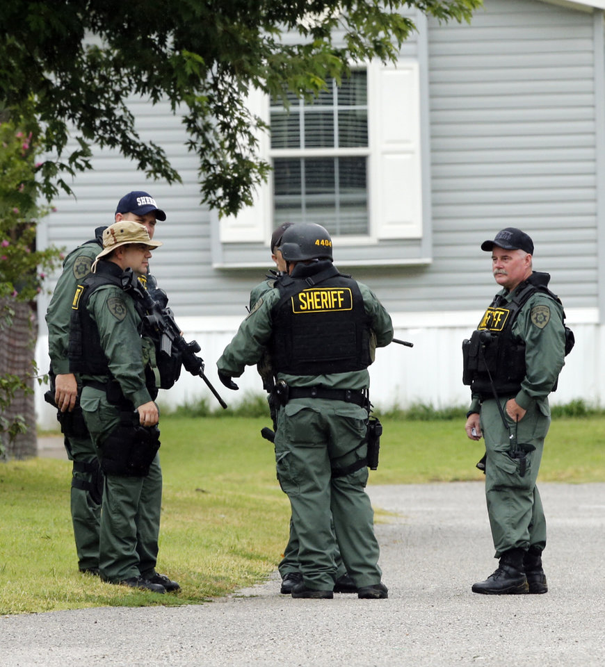 Photo -  Law enforcement officers from McClain County, Oklahoma Highway Patrol and numerous other local departments search the Adkins Hill Mobile Home Village for a man who escaped custody after being arrested at the scene of a burglary. PHOTO BY STEVE SISNEY, THE OKLAHOMAN   STEVE SISNEY -