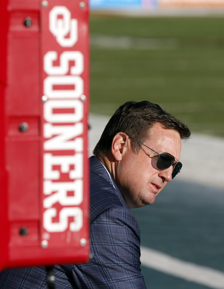Photo - Bob Stoops takes a moment to reflect hours before the OU-Texas game in October. (Photo by Nate Billings)