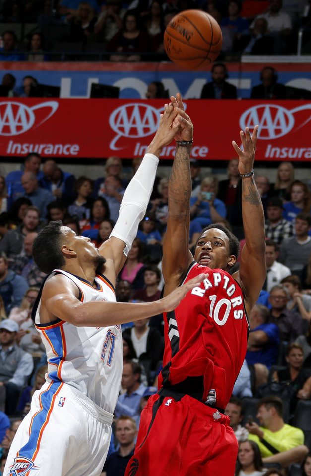 Photo - Toronto's DeMar DeRozan (10) shoots over Oklahoma City's Andre Roberson (21) during an NBA basketball game between the Oklahoma City Thunder and the Toronto Raptors at Chesapeake Energy Arena on Wednesday, Nov. 4, 2015. The Thunder lost 103-98. Photo by Bryan Terry, The Oklahoman
