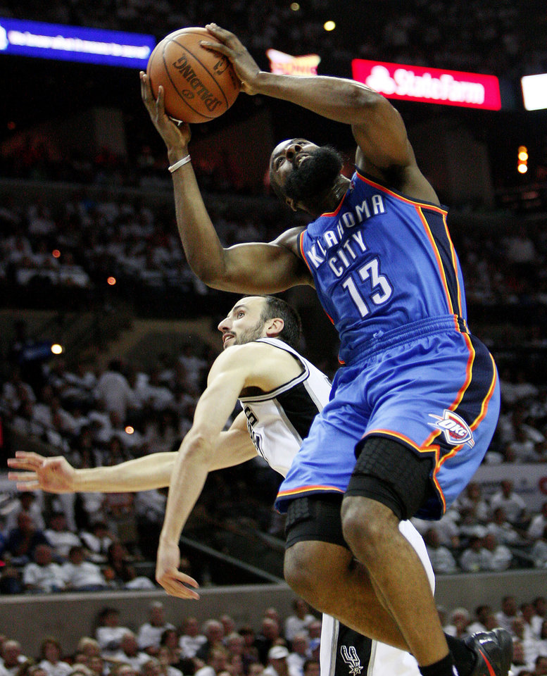 Oklahoma City's James Harden (13) is fouled by San Antonio's Manu Ginobili (20) during Game 5 of the Western Conference Finals between the Oklahoma City Thunder and the San Antonio Spurs in the NBA basketball playoffs at the AT&T Center in San Antonio, Monday, June 4, 2012. Photo by Nate Billings, The Oklahoman