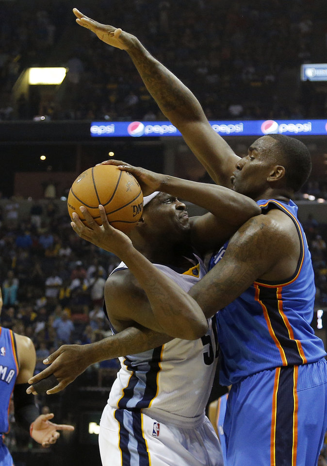 Photo - Oklahoma City's Kendrick Perkins (5) defends Memphis' Zach Randolph (50) during Game 4 in the first round of the NBA playoffs between the Oklahoma City Thunder and the Memphis Grizzlies at FedExForum in Memphis, Tenn., Saturday, April 26, 2014. PHOTO BY BRYAN TERRY, The Oklahoman