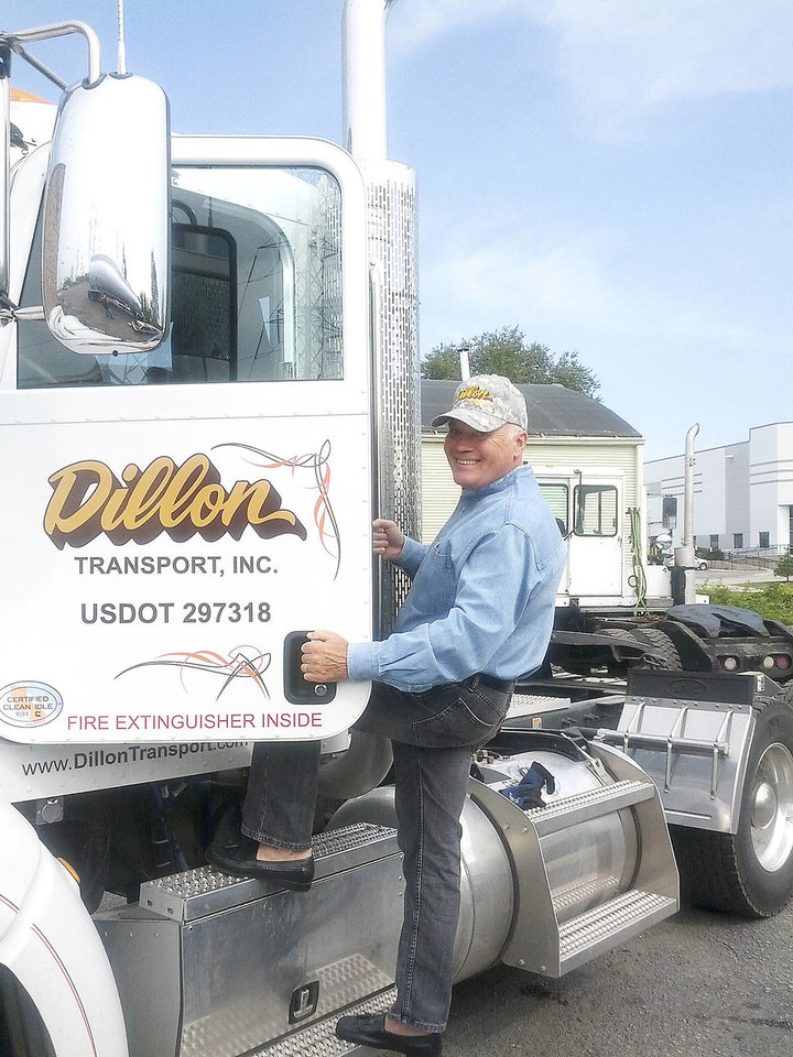 Phil Crofts, marketing director at Illinois-based Dillon Transport Inc., stands with one of the trucking company�s new natural gas-powered trucks.  PHOTO PROVIDED BY DILLON TRANSPORT INC.