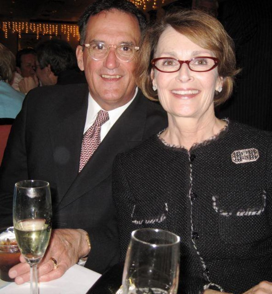 WEDDING RECEPTION...Ron and Linda James were ready for toasting at Denise Duong and Matt Seikel\'s wedding reception. (Photo by Helen Ford Wallace).