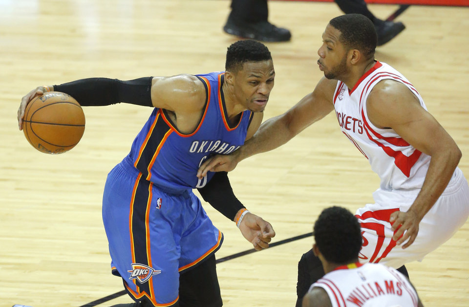 Photo -  Russell Westbrook tries to get past Eric Gordon during Tuesday's game in Houston. [Photo by Sarah Phipps, The Oklahoman]