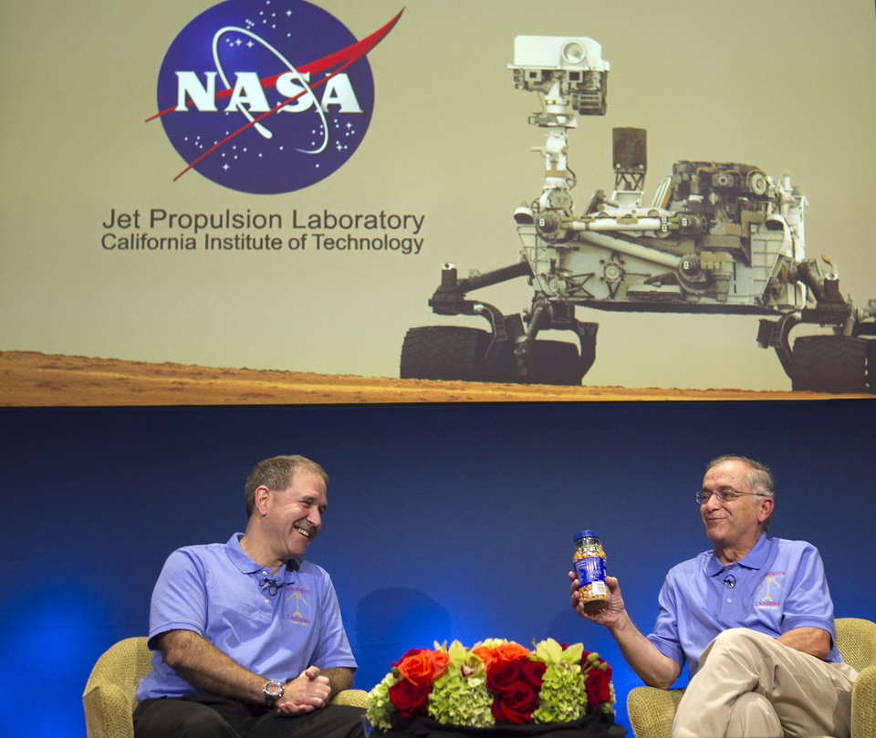 Photo -   John Grunsfeld, NASA Associate Administrator, NASA Headquarters, left, and Charles Elachi, JPL Director, NASA Jet Propulsion Laboratory, present a can of