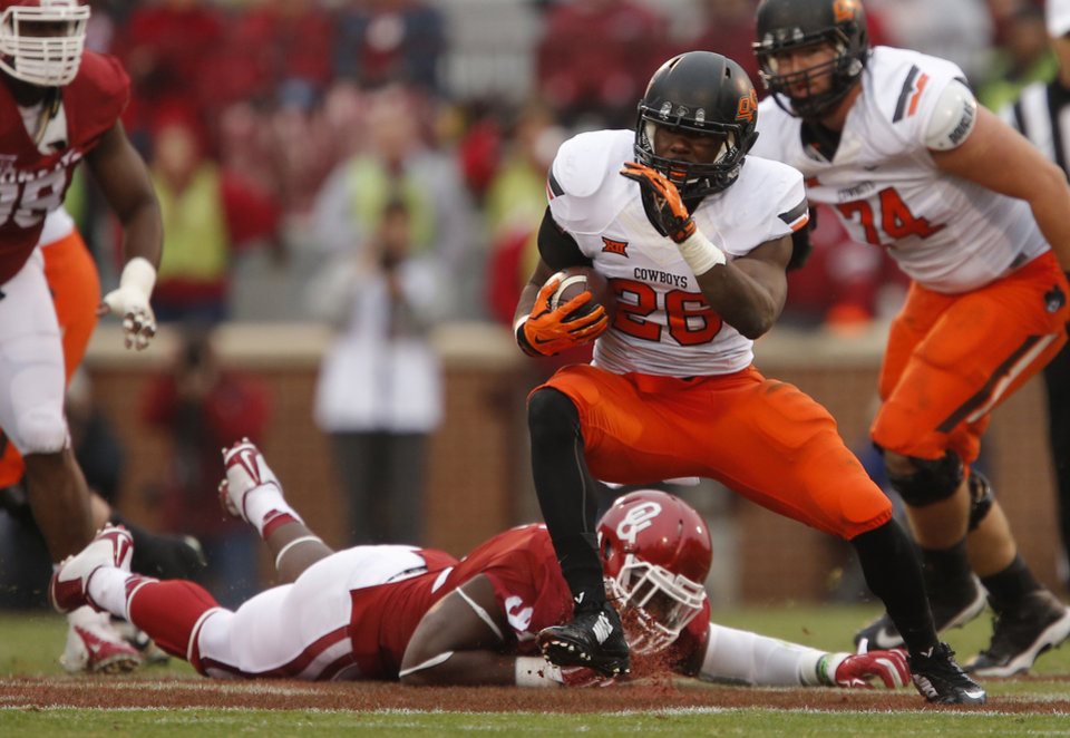 Photo - Oklahoma State's Desmond Roland (26) runs during a Bedlam college football game between the University of Oklahoma Sooners (OU) and the Oklahoma State Cowboys (OSU) at Gaylord Family-Oklahoma Memorial Stadium in Norman, Okla., Saturday, Dec. 6, 2014. Photo by Bryan Terry, The Oklahoman