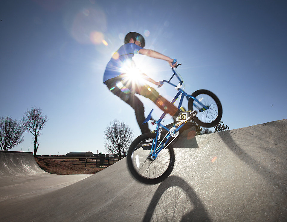 Cale Wright, 11, rides his bicycle he got for Christmas at Mitch Park in Edmond, Wednesday, December 28, 2011. Photo by David McDaniel, The Oklahoman ORG XMIT: KOD