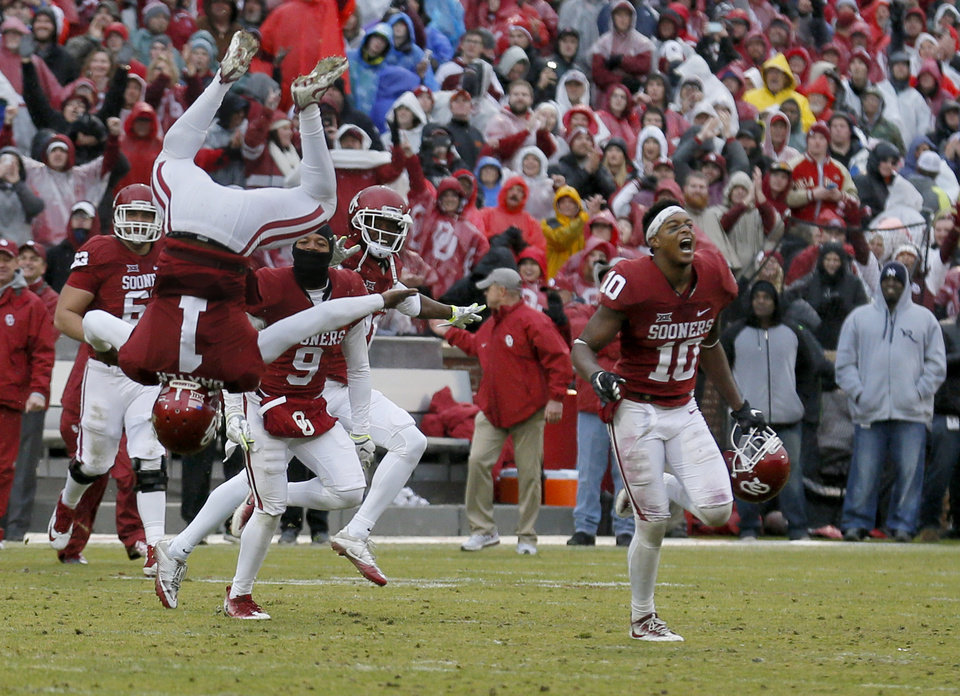 Photo - Oklahoma's Jarvis Baxter (1) celebrates with Oklahoma's Steven Parker (10) following the Bedlam college football game between the Oklahoma Sooners (OU) and the Oklahoma State Cowboys (OSU) at Gaylord Family - Oklahoma Memorial Stadium in Norman, Okla., Saturday, Dec. 3, 2016. OU won 38-20. Photo by Sarah Phipps, The Oklahoman