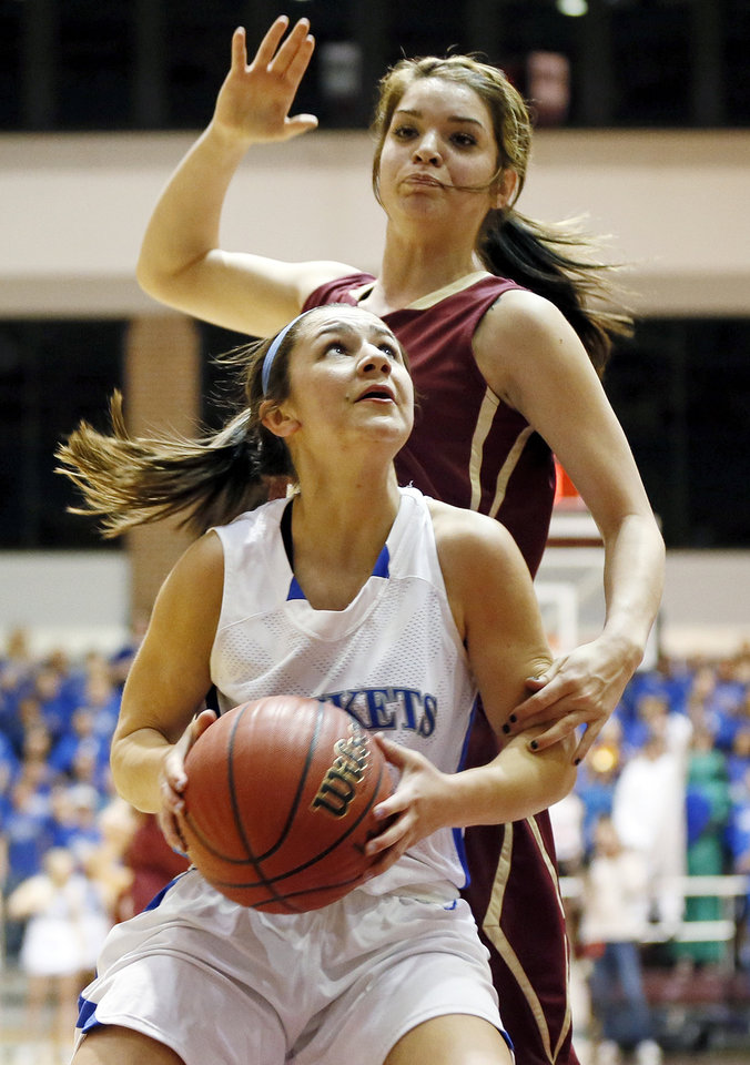Mount St. Mary's Aimee Rishcard (2) tries to get the ball past Byng's Raetchel Gray (32) during a Class 4A girls high school basketball game in the first round of the state tournament at the Sawyer Center on the campus of Southern Nazarene University in Bethany, Okla., Thursday, March 7, 2013. Photo by Nate Billings, The Oklahoman