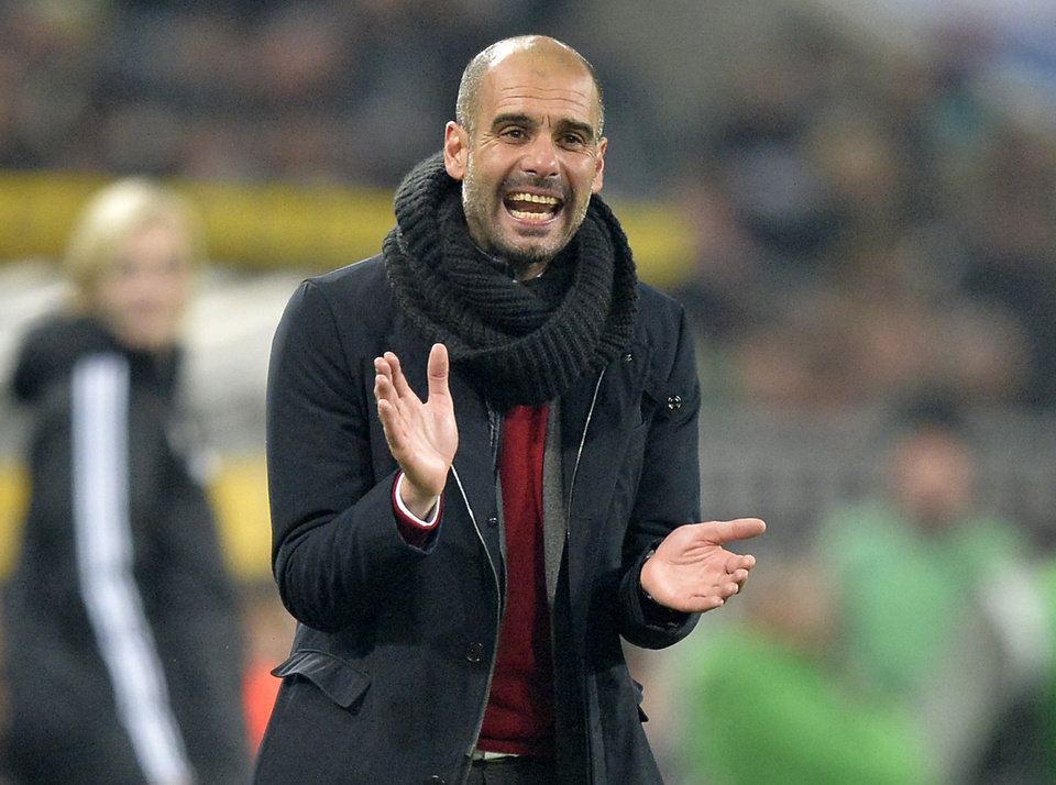 Photo - Bayern head coach Pep Guardiola of Spain claps his hands for his team during the German Bundesliga soccer match between Borussia Moenchengladbach and Bayern Munich in Moenchengladbach, Germany, Friday, Jan. 24, 2014. Bayern defeated Moenchengladbach with 2-0. (AP Photo/Martin Meissner)