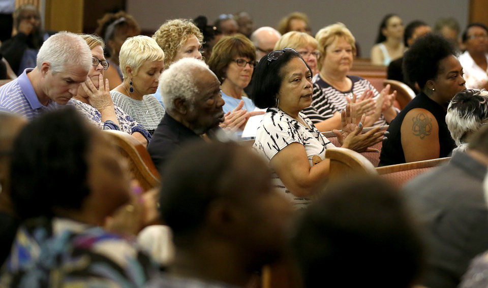 Photo -  People listen Tuesday during a public forum about unsolved homicides hosted by The Oklahoman at Prospect Baptist Church in Oklahoma City. [Photo by Bryan Terry, The Oklahoman]