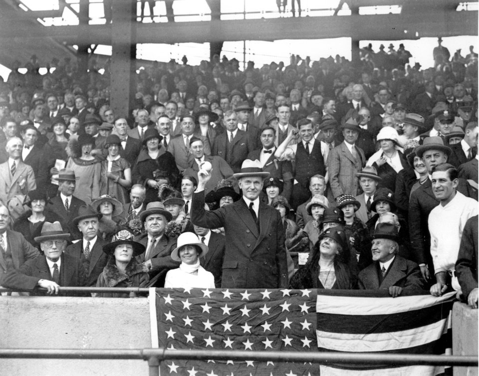 FILE - In this Oct. 4, 1924, file photo, U.S. President Calvin Coolidge throws out the ball for the opening game of the 1924 World Series between the Washington Senators and the New York Giants in Washington. The Senators stormed to the top of the league the year after a losing season, had a star pitcher who was the subject of intense national discussion, and won praise from Coolidge for their performance. Like this year's Washington Nationals, the 1924 World Series champion Senators generated excitement in a city starved for a baseball winner. The Nationals will begin their quest for the city's second championship when the team's playoff series begins Sunday. (AP Photo/File)