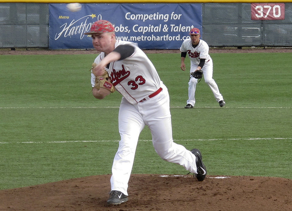 Photo - In this photo made Saturday, March 29, 2014, University of Hartford pitcher Sean Newcomb delivers during a baseball game against Stony Brook in Hartford, Conn.  The 6-foot-5 left hander is considered a top major-league prospect. (AP Photo/Pat Eaton-Robb)