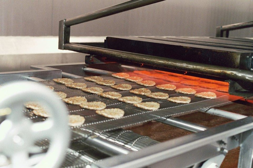 Sausage patties cook at Lopez Foods in Oklahoma City. <strong> - PROVIDED</strong>