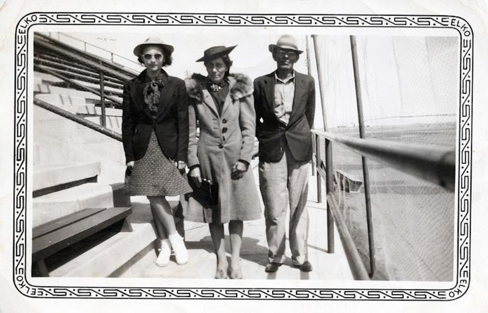 Photo - Pauline Arnett Hodges is shown at left. Above, Hodges, age 11, stands with her parents, Dora and Paul, in a stadium in 1939.  PHOTOs PROVIDED  PROVIDED