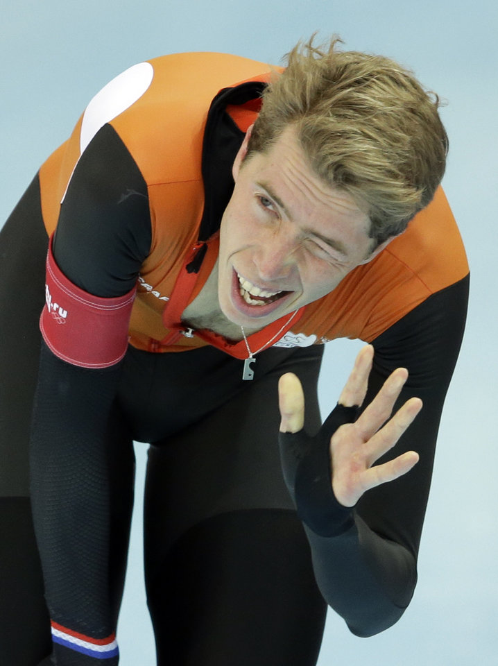 Photo - Jorrit Bergsma of the Netherlands winks to acknowledge the crowd after setting a new world record in the men's 10,000-meter speedskating race at the Adler Arena Skating Center during the 2014 Winter Olympics in Sochi, Russia, Tuesday, Feb. 18, 2014. (AP Photo/Patrick Semansky)
