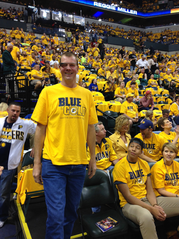 Photo - In this May 18, 2014 photo provided by Pacers.com, former indiana Pacers player Rik Smits smiles while wearing Google glasses during the Eastern Conference Finals at Bankers Life Fieldhouse in Indianapolis. The use of Glass in sports has progressed from trendy athletes dipping their toes in the water to a tool for teams looking to draw fans to arenas and stadiums, and then keep their focus on the action, instead of their omnipresent smartphones and tablets.  (AP Photo/Pacers.com, Celeste Ballou)