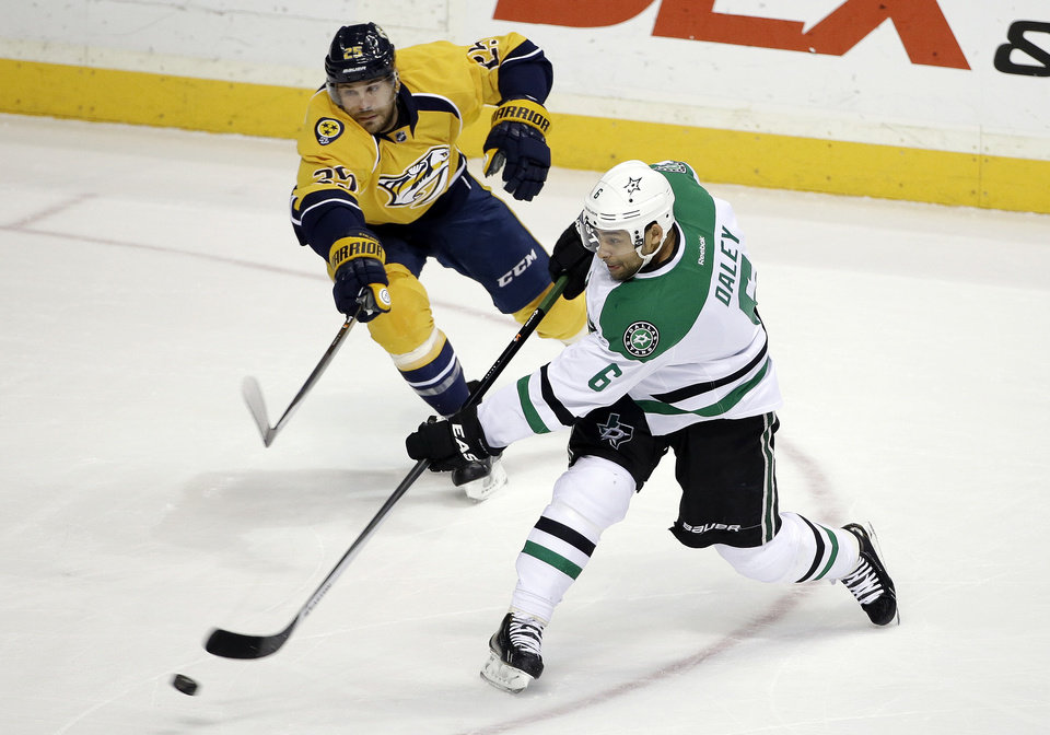 Photo - Dallas Stars defenseman Trevor Daley (6) shoots as he is defended by Nashville Predators forward Viktor Stalberg (25), of Sweden, in the first period of an NHL hockey game Monday, Jan. 20, 2014, in Nashville, Tenn. (AP Photo/Mark Humphrey)