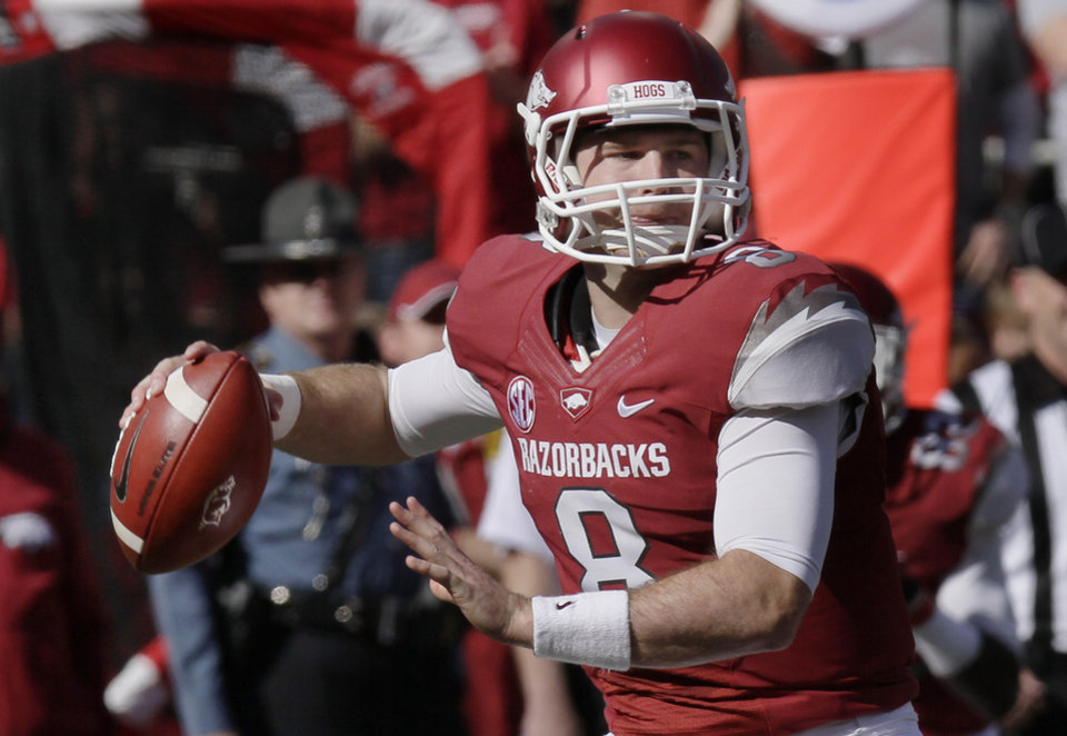 Arkansas quarterback Tyler Wilson (8) passes during the first half of an NCAA college football game against Tulsa in Fayetteville, Ark., Saturday, Nov. 3, 2012. (AP Photo/Danny Johnston)