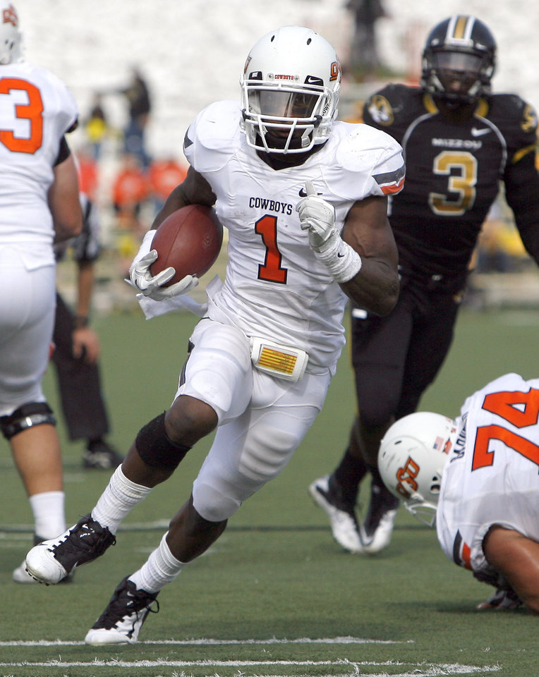 Photo - Oklahoma State's Joseph Randle (1) runs up field during a college football game between the Oklahoma State University Cowboys (OSU) and the University of Missouri Tigers (Mizzou) at Faurot Field in Columbia, Mo., Saturday, Oct. 22, 2011. Photo by Sarah Phipps, The Oklahoman