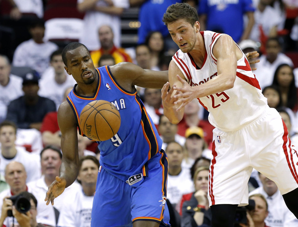 Oklahoma City\'s Serge Ibaka goes for the ball beside Houston\'s Chandler Parsons during Game 3 in the first round of the NBA playoffs between the Oklahoma City Thunder and the Houston Rockets at the Toyota Center in Houston, Texas, Sat., April 27, 2013. Photo by Bryan Terry, The Oklahoman