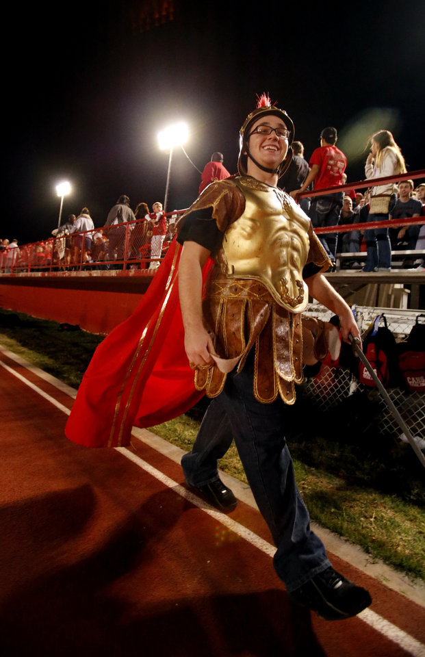 Photo - Carl Albert mascot Ruben Carrasquillo, walks the sidelines as his team plays the Del City Eagles in Class 5A, first round, playoff action in high school football on Friday, Nov. 9, 2012 in Del City, Okla.   Photo by Steve Sisney, The Oklahoman