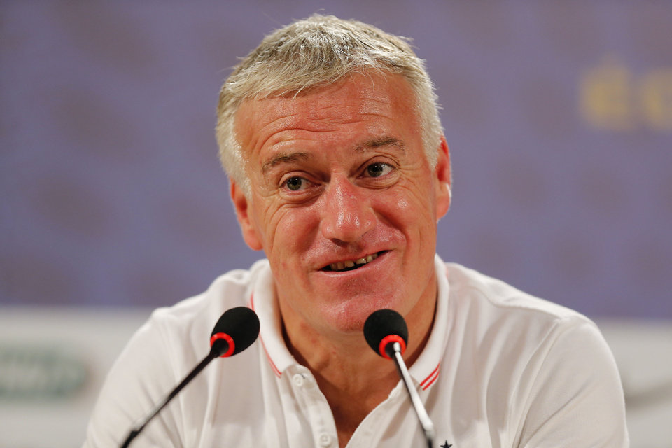 Photo - France head coach Didier Deschamps answers journalists' questions during a press conference at the Teatro Pedro II, in Ribeirao Preto, Brazil, Friday, July 1, 2014. France will face Germany in their World Cup quarterfinal, Friday. (AP Photo/David Vincent)