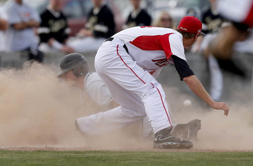 Norman North's Dylan Sterling slides to third on his way to scoring game-winning run as Yukon's Mason McAlister watches the ball go past him in the seventh inning against Yukon during a Class 6A state baseball tournament game in Shawnee, Okla., Friday, May 10, 2013. Photo by Bryan Terry, The Oklahoman