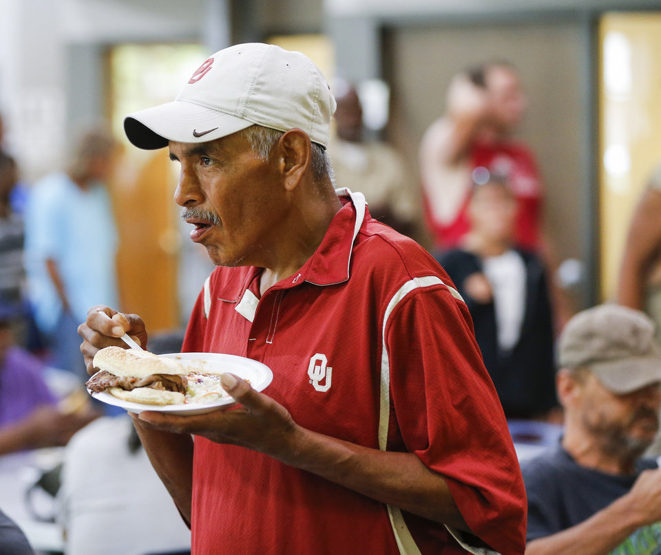 Photo -  Chris Whitestar eats during a May 24 lunch of rib-eye steak sandwiches, coleslaw and beans made by the Oklahoma Cattlemen's Association and the Oklahoma Beef Council at the Homeless Alliance's WestTown campus in Oklahoma City. [Photo by Nate Billings, The Oklahoman]