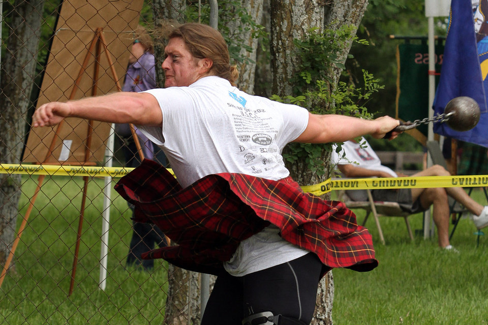Duncan McCallum of Keller, Texas throws the four stone (56 pound) weight during the Iron Thistle Festival in Yukon, Saturday, April 28th, 2012. PHOTO BY HUGH SCOTT, FOR THE OKLAHOMAN  ORG XMIT: KOD