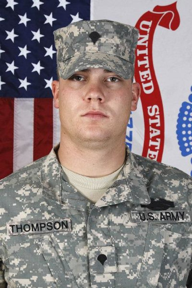 Photo - IRAQ WAR / OKLAHOMA NATIONAL GUARD / CH-47 CHINOOK HELICOPTER ACCIDENT / DEATHS: In this photo released by the Oklahoma National Guard, Cpl. Michael Thompson, Co B, 2/149 Aviation, Oklahoma Army National Guard, is pictured. Thompson was killed in Iraq, Sept. 18, 2008. (AP Photo/Visual Information, Oklahoma National Guard) ORG XMIT: OKSO102