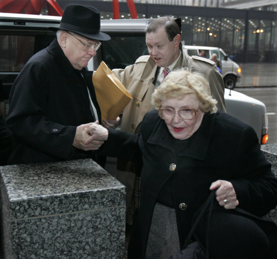 Photo - FILE - In this March 6, 2006 file photo, former Illinois Gov. George Ryan, left, arrives at federal court in Chicago for his racketeering and corruption trial with his wife, Lura Lynn, front, and chief defense counsel Dan K. Webb. He was convicted of racketeering and fraud charges in April 2006. Ryan, who reported to prison in November 2007, is scheduled to be released from a Terre Haute, Ind., prison Wednesday, Jan. 30, 2013, and enter a halfway house in Chicago. Both his wife and a brother died while he was in prison. (AP Photo/M. Spencer Green, File)