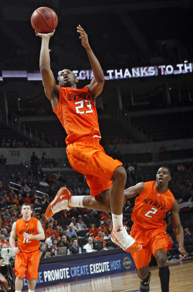 Photo - ALL-COLLEGE BASKETBALL TOURNAMENT: OSU's James Anderson (23) puts up a shot during the second half of the college basketball game between Oklahoma State University (OSU) and La Salle University in the All-College Basketball Classic at the Ford Center on Monday, Dec. 21, 2009, in Oklahoma City, Okla.   Photo by Chris Landsberger, The Oklahoman ORG XMIT: KOD