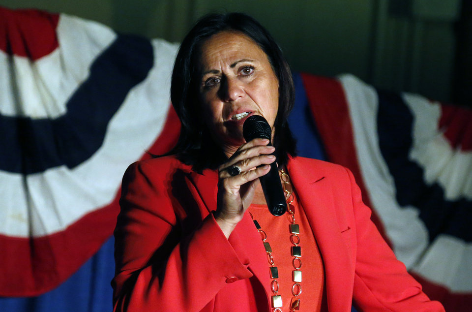 Photo - Democratic state Sen. Angela Giron gives her concession speech after she lost in a recall vote in Pueblo, Colo., Tuesday Sept. 10, 2013. Two Colorado state lawmakers who backed gun-control measures in the aftermath of the mass shootings in Colorado and Connecticut last year have been ousted in recall elections. (AP Photo/Brennan Linsley)