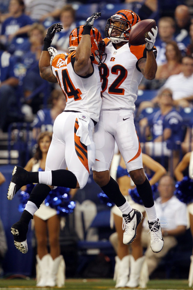 Photo -   Cincinnati Bengals wide receiver Marvin Jones, right, celebrates a touchdown with running back Dan Herron against the Indianapolis Colts in the first half of an NFL preseason football game in Indianapolis, Thursday, Aug. 30, 2012. (AP Photo/John Sommers II)