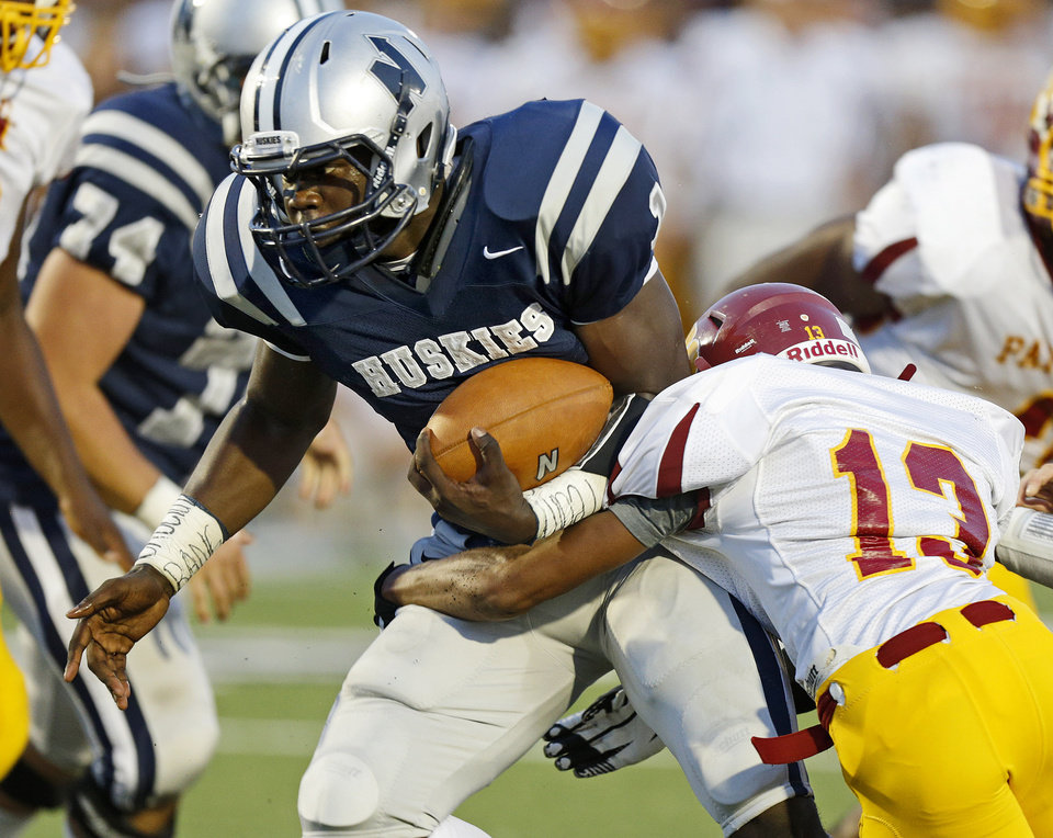 Photo - Edmond North's Michael Farmer runs past Putnam City North's Dylan Peevy for a touchdown during a high school football game at Wantland Stadium in Edmond, Okla., Friday, September 21, 2012. Photo by Bryan Terry, The Oklahoman