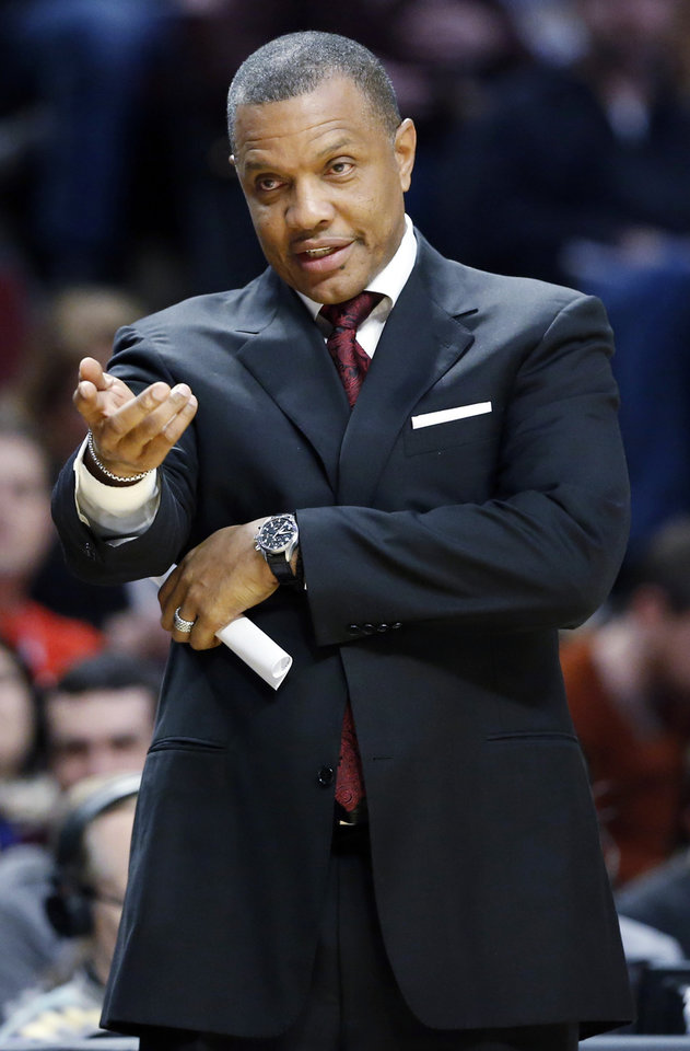 Phoenix Suns coach Alvin Gentry gestures during the first half of the Suns' NBA basketball game against the Chicago Bulls in Chicago on Saturday, Jan. 12, 2013. (AP Photo/Nam Y. Huh)