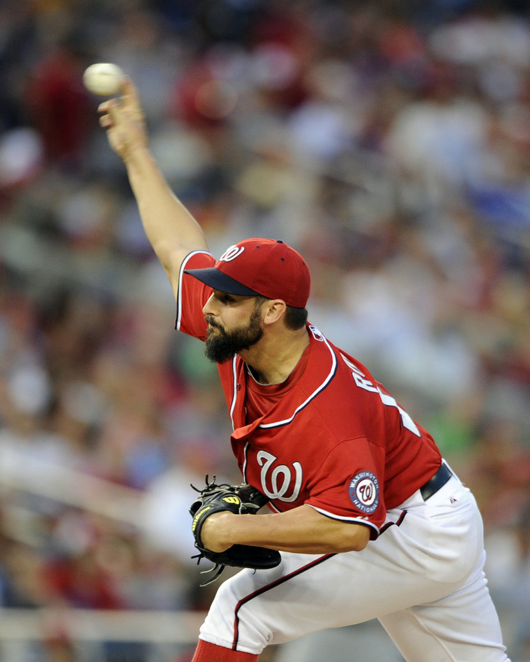 Photo - Washington Nationals starting pitcher Tanner Roark delivers a pitch against the Milwaukee Brewers during the third inning of a baseball game, Saturday, July 19, 2014, in Washington. (AP Photo/Nick Wass)