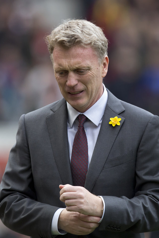 Photo - Manchester United's manager David Moyes takes to the touchline before his team's English Premier League soccer match against Liverpool at Old Trafford Stadium, Manchester, England, Sunday March 16, 2014. (AP Photo/Jon Super)