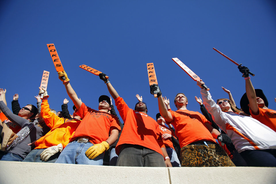 Photo - Oklahoma State fans cheer for their Cowboys during the college football game between the Oklahoma State University Cowboys (OSU) and the Baylor University Bears at Boone Pickens Stadium in Stillwater, Okla., Saturday, Nov. 6, 2010. Photo by Chris Landsberger, The Oklahoman