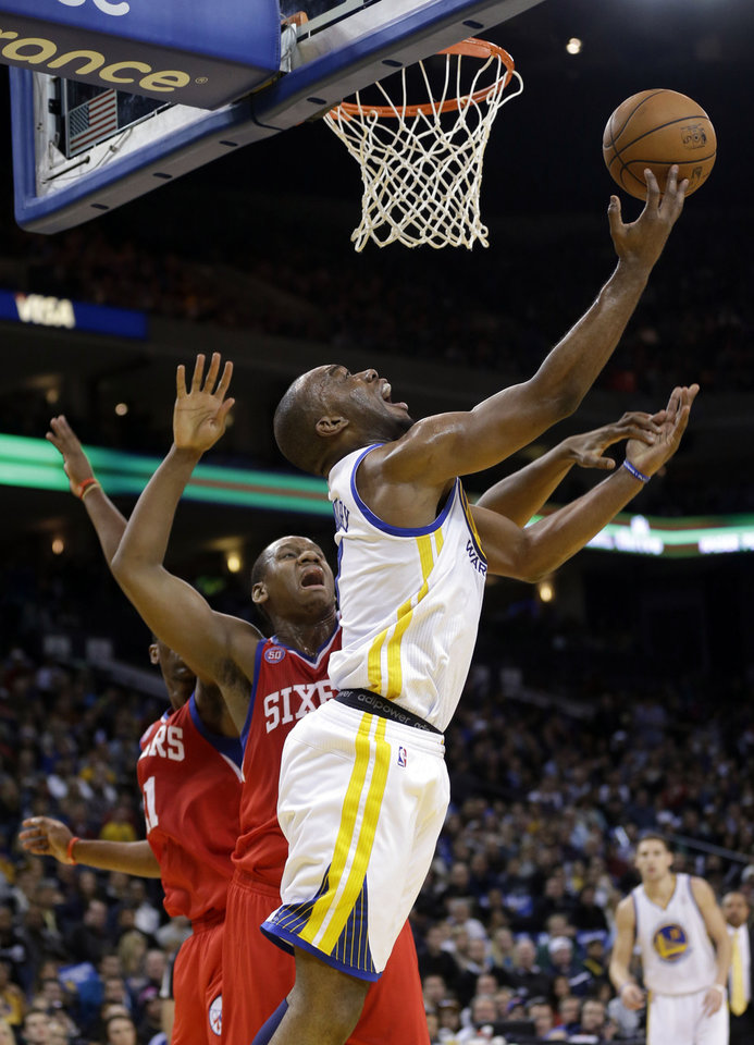 Golden State Warriors' Carl Landry (7) shoots next to Philadelphia 76ers' Lavoy Allen, middle, during the first half of an NBA basketball game in Oakland, Calif., Friday, Dec. 28, 2012. (AP Photo/Marcio Jose Sanchez)