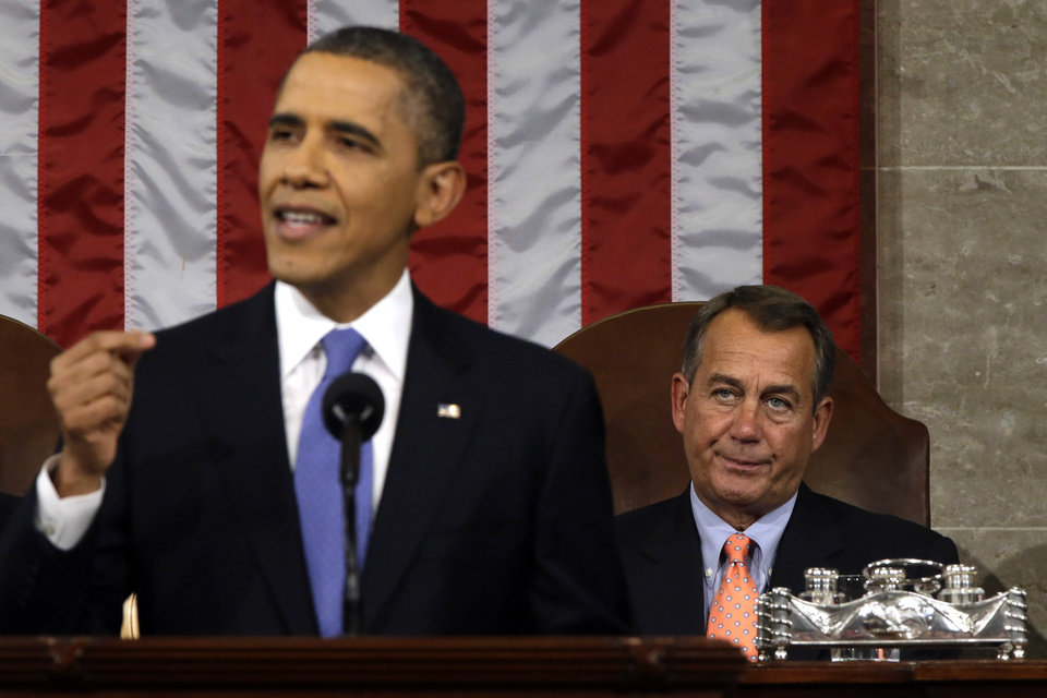 House Speaker John Boehner of Ohio listens at right as President Barack Obama gives his State of the Union address during a joint session of Congress on Capitol Hill in Washington, Tuesday Feb. 12, 2013. (AP Photo/Charles Dharapak, Pool) ORG XMIT: CAP518
