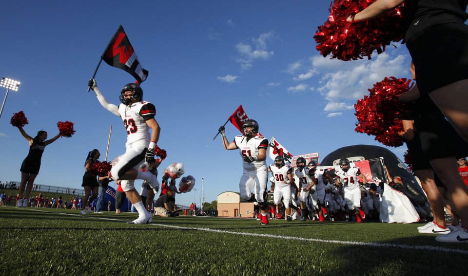 Photo - Westmoore players take the field as Moore High School and Westmoore play football on Friday, Aug. 31, 2012 in Moore, Okla.  Photo by Steve Sisney, The Oklahoman