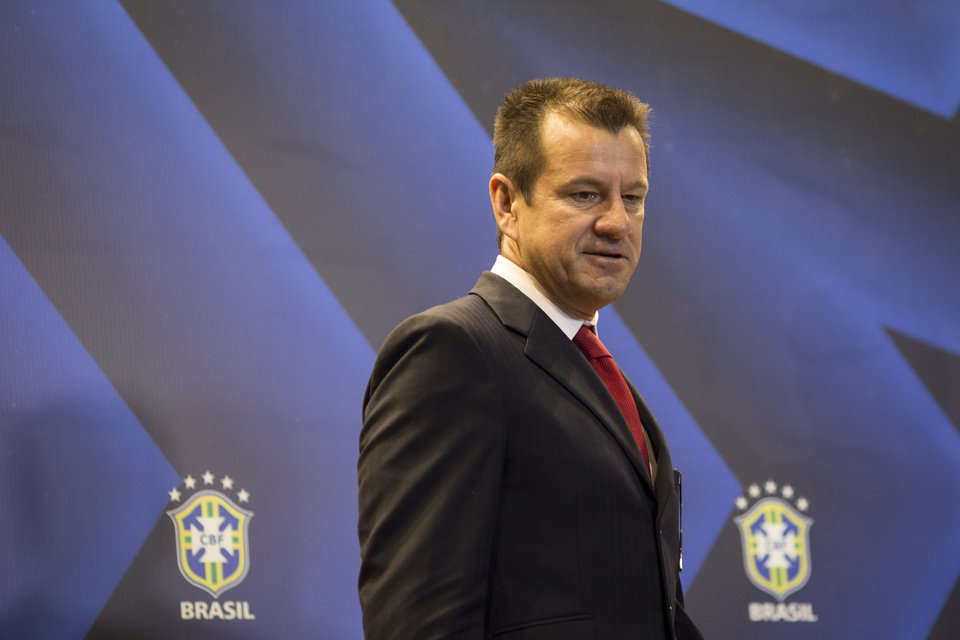 Photo - Brazil soccer coach Dunga, arrives to a press conference announcing him as the new head coach of the Brazilian national team, in Rio de Janeiro, Brazil, Tuesday, July 22, 2014. Dunga returned to the post replacing Luiz Felipe Scolari, who resigned after Brazil failed to win the 2014 World Cup eliminated in a 7-1 loss to Germany in the semifinals. (AP Photo/Felipe Dana)