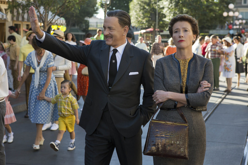 """Photo - This undated photo released by Disney shows Tom Hanks, left, as Walt Disney showing Disneyland to Emma Thompson as """"Mary Poppins"""" author P.L. Travers, in Disney's"""