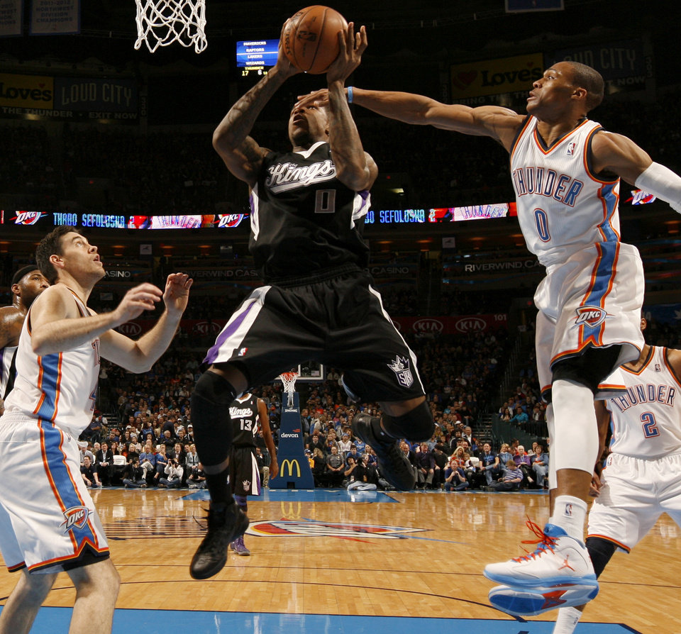Oklahoma City's Nick Collison (4) and Russell Westbrook (0) defend Sacramento's Thomas Robinson (0)  during an NBA basketball game between the Oklahoma City Thunder and the Sacramento Kings at Chesapeake Energy Arena in Oklahoma City, Friday, Dec. 14, 2012. Photo by Bryan Terry, The Oklahoman