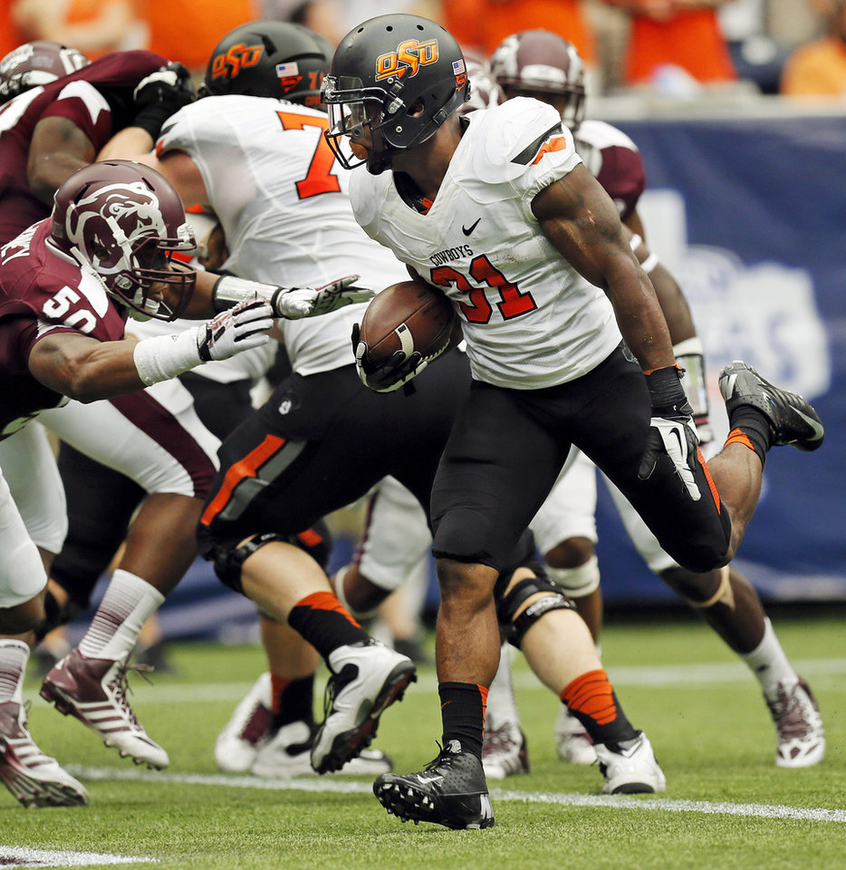 Oklahoma State's Jeremy Smith (31) rushes for a touchdown in the third quarter during the AdvoCare Texas Kickoff college football game between the Oklahoma State University Cowboys (OSU) and the Mississippi State University Bulldogs (MSU) at Reliant Stadium in Houston, Saturday, Aug. 31, 2013. OSU won, 21-3. Photo by Nate Billings, The Oklahoman