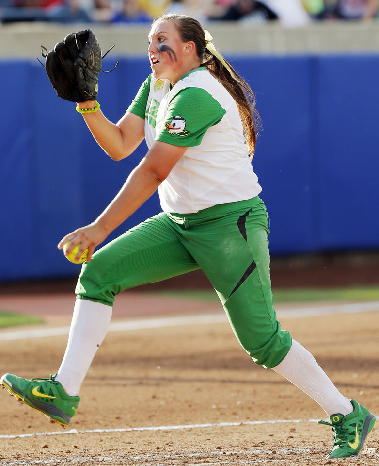 Photo - Oregon's Cheridan Hawkins (11) pitches during Game 5 of the Women's College World Series softball tournament between Florida and Oregon at ASA Hall of Fame Stadium in Oklahoma City, Friday, May 30, 2014. Photo by Nate Billings, The Oklahoman