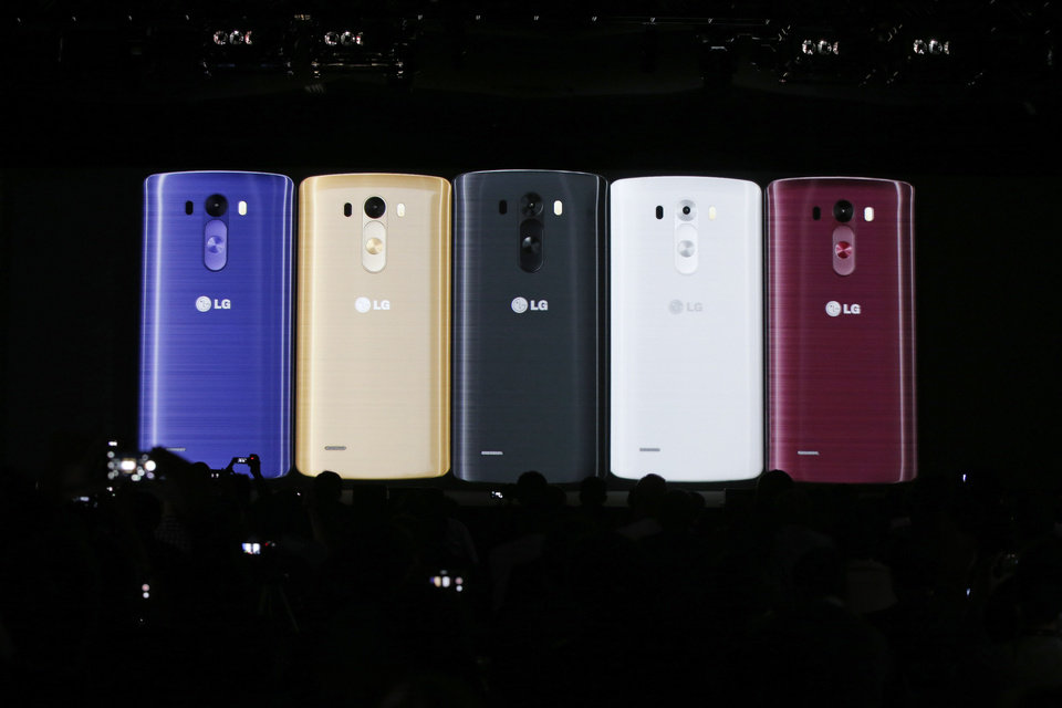 Photo - Images of the newly-unveiled LG smartphone, called the G3, are presented at a press event in London, Tuesday, May 27, 2014. (AP Photo/Lefteris Pitarakis)